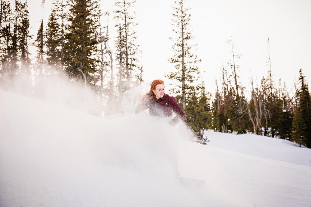 big-sky-montana-winter-wedding-breanna-formals-bride-snowboarding.jpg