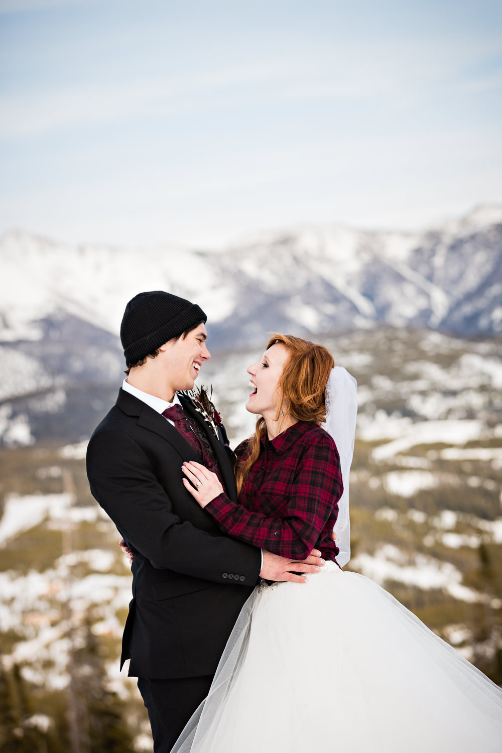 big-sky-montana-winter-wedding-breanna-formals-groom-bride-snowboarding.jpg