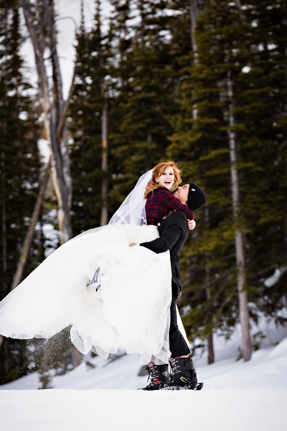 big-sky-montana-winter-wedding-breanna-formals-groom-lifts-bride.jpg