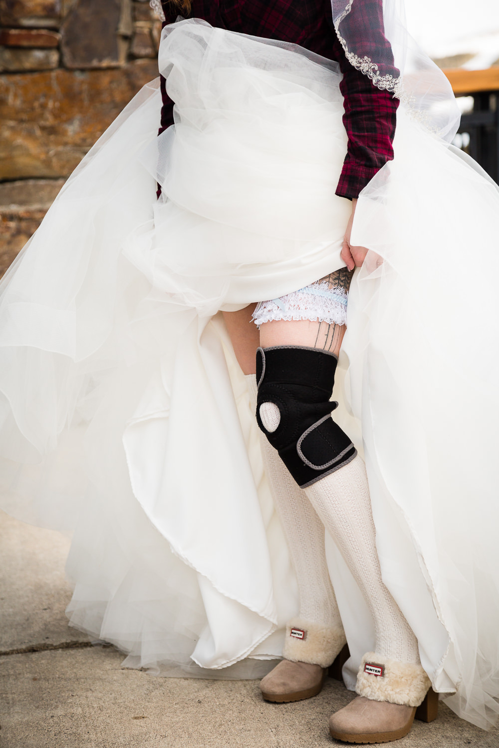 big-sky-montana-winter-wedding-breanna-reception-bride-leg-brace.jpg