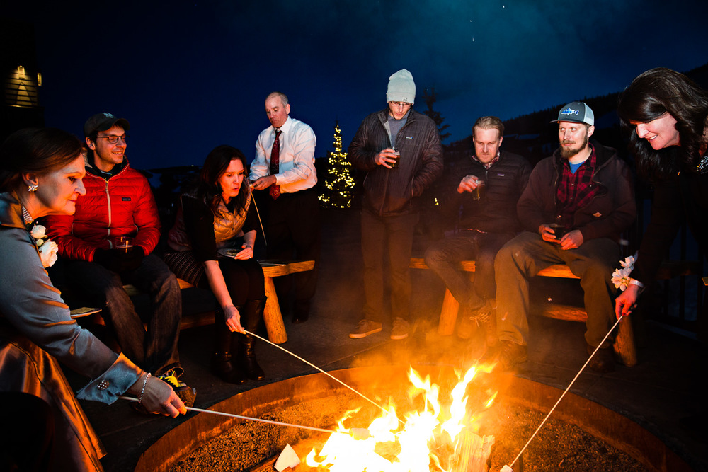 big-sky-montana-winter-wedding-breanna-reception-guests-roast-smores.jpg