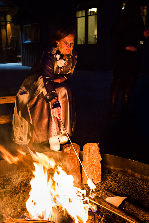 big-sky-montana-winter-wedding-breanna-reception-mom-roasts-marshmallow.jpg