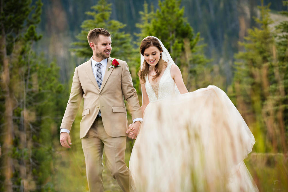 big-sky-wedding-becky-brockie-photography-couple-walk-forest.jpg