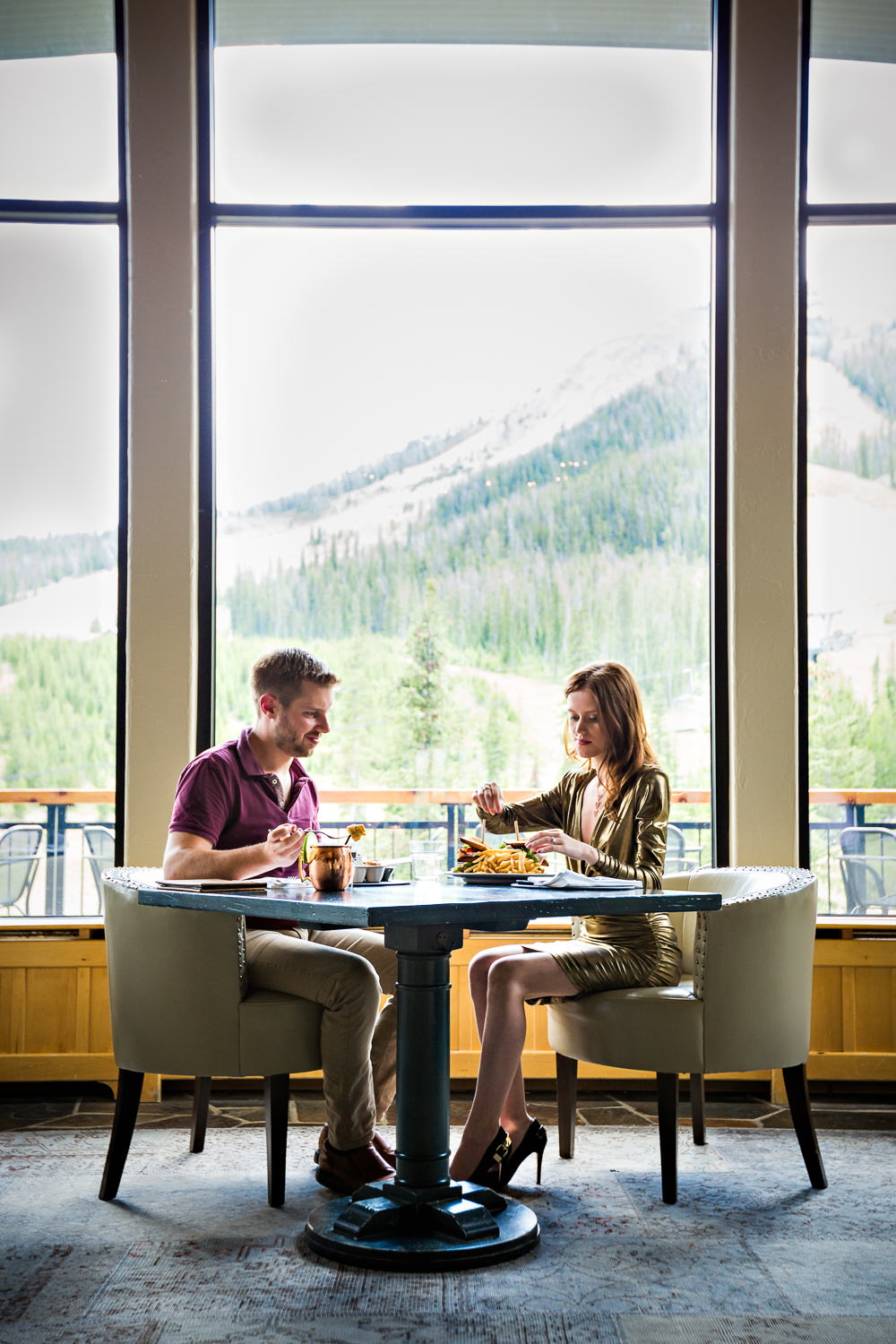 big-sky-montana-engagement-moonlight-basin-tavern-couple-eating-meal.jpg