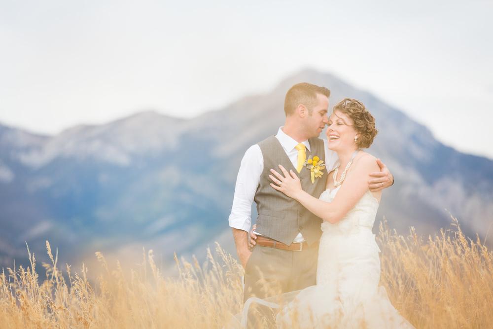bozeman-wedding-big-yellow-barn-couple-laughing-near-bridger-mountains.jpg