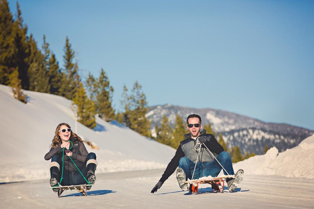 big-sky-montana-winter-engagement-session-couple-goes-sledding.jpg