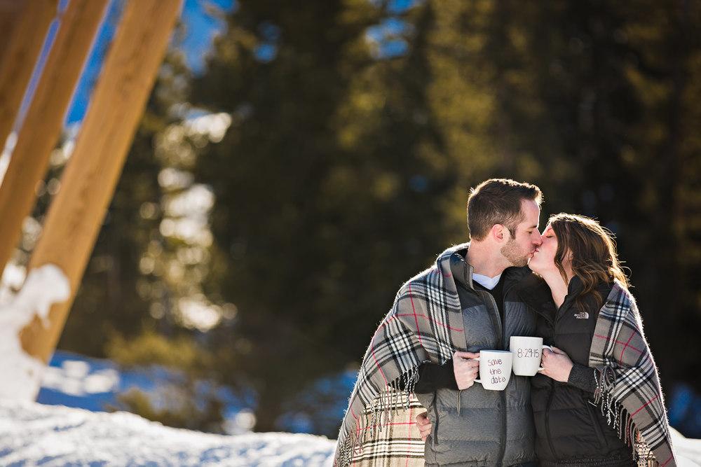 big-sky-montana-winter-engagement-session-couple-kissing-save-date-mugs.jpg
