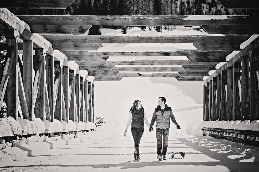 big-sky-montana-winter-engagement-session-couple-pulling-sleds.jpg