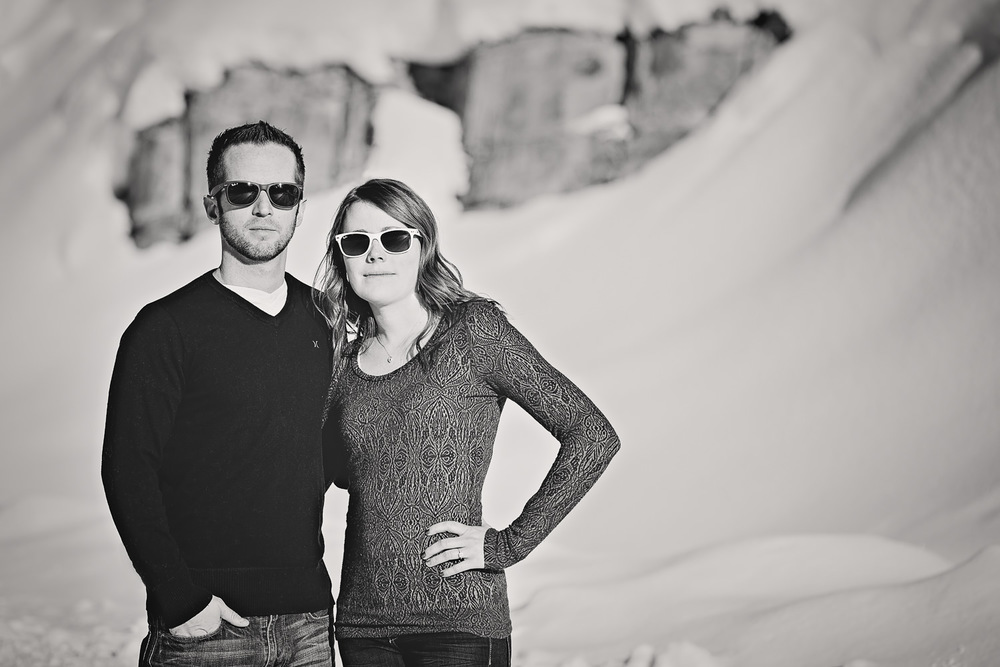 big-sky-montana-winter-engagement-session-couple-wearing-ray-bans.jpg