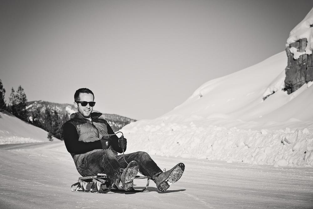 big-sky-montana-winter-engagement-session-man-sleds.jpg