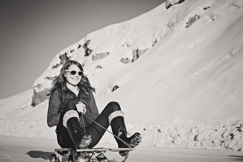 big-sky-montana-winter-engagement-session-woman-sleds.jpg