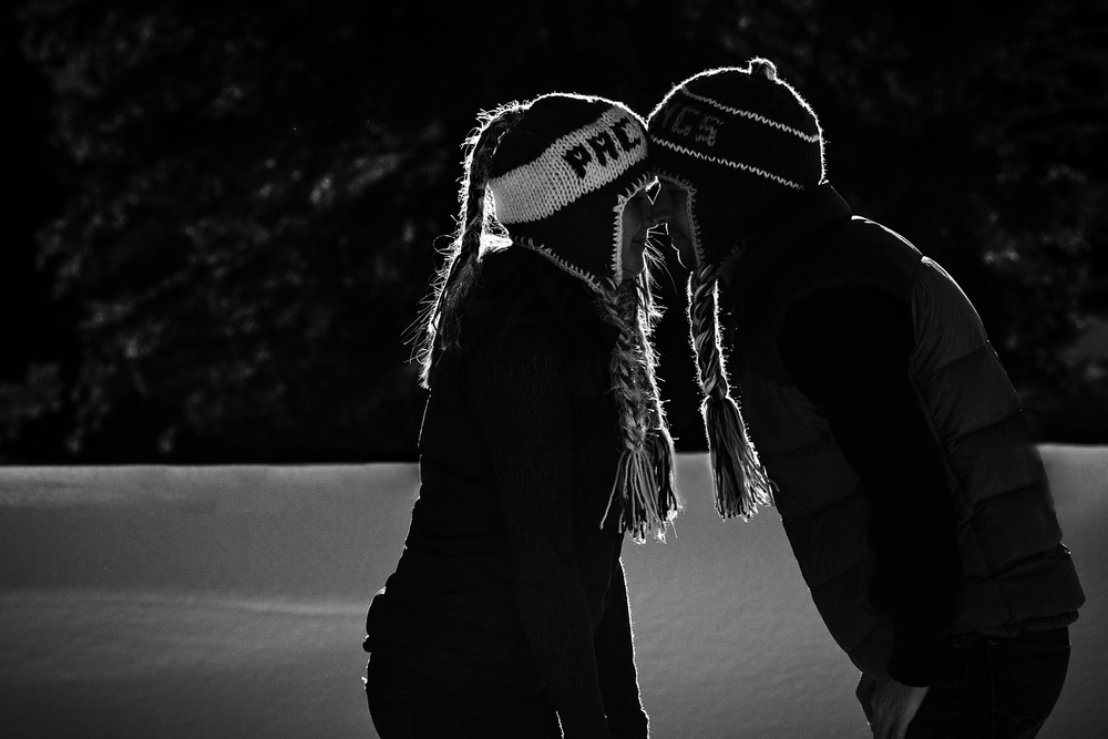 big-sky-montana-winter-engagement-session-black-and-white-couple-in-snow.jpg