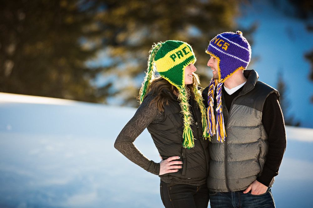big-sky-montana-winter-engagement-session-couple-looking-at-one-another.jpg