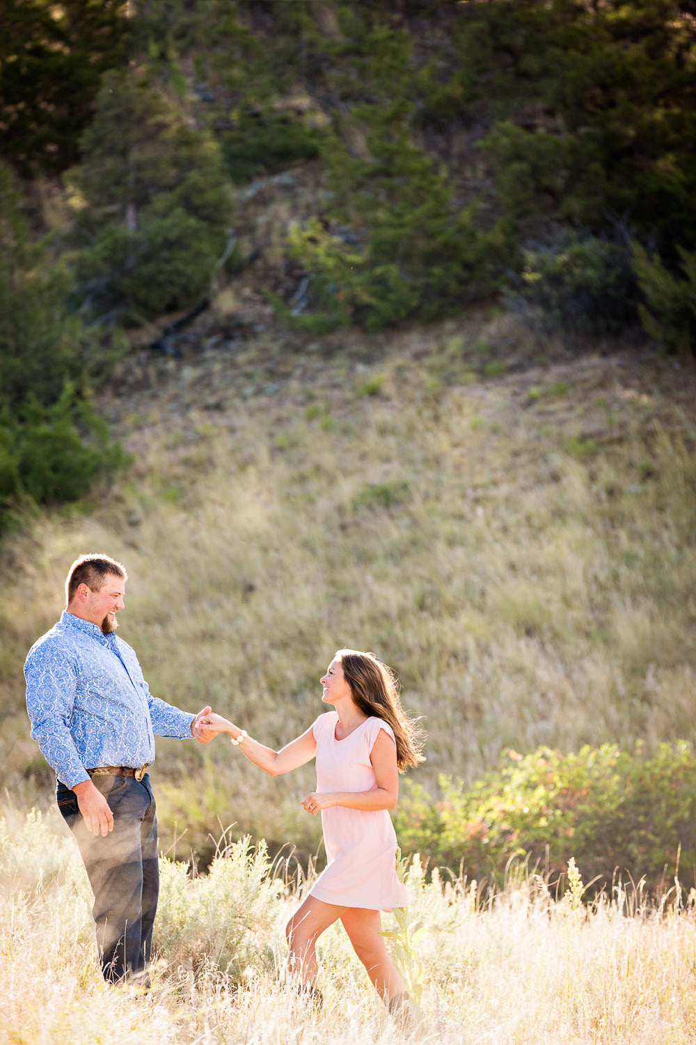 billings-montana-engagement-session-couple-dancing-in-long-grass.jpg