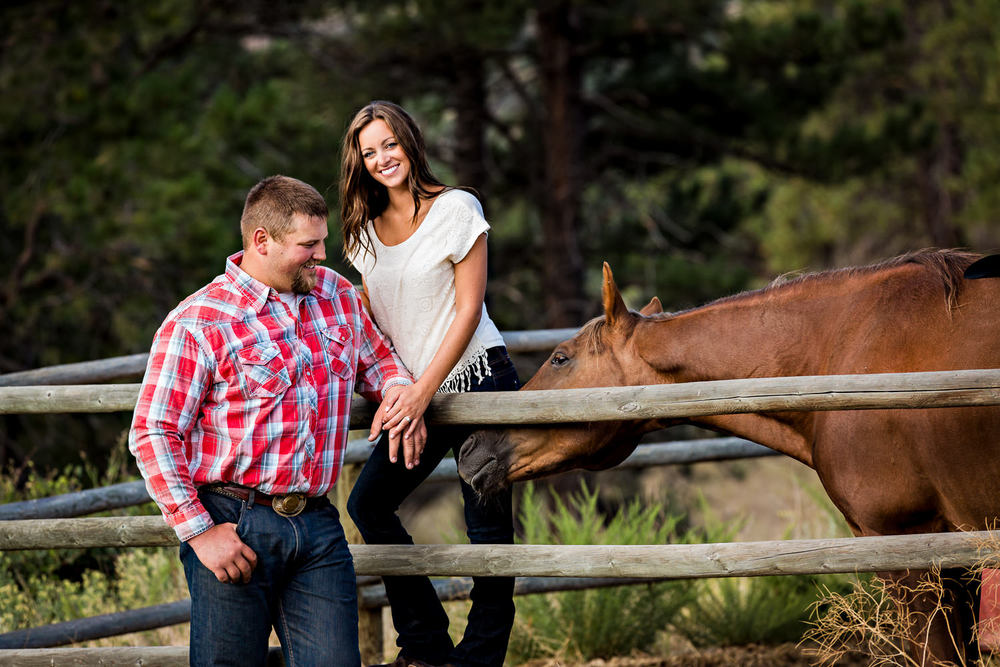 billings-montana-engagement-session-couple-play-with-horse.jpg