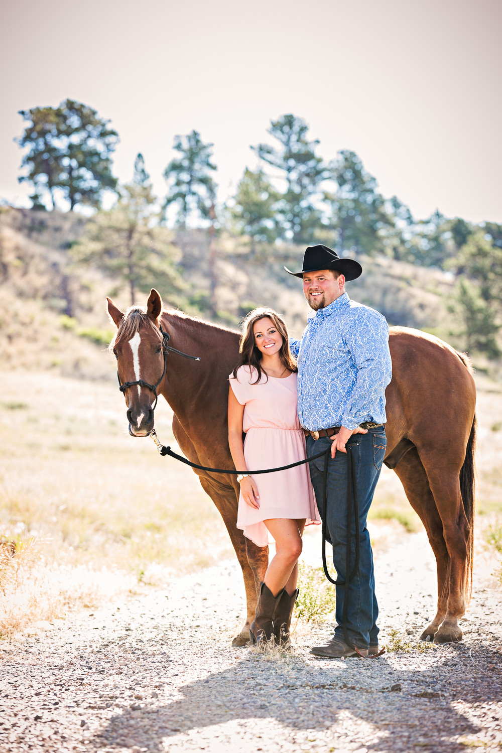 billings-montana-engagement-session-couple-pose-with-horse.jpg