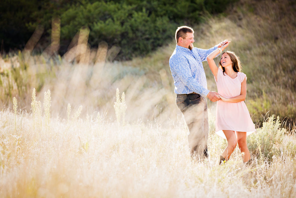 billings-montana-engagement-session-happy-couple-dancing-in-field.jpg