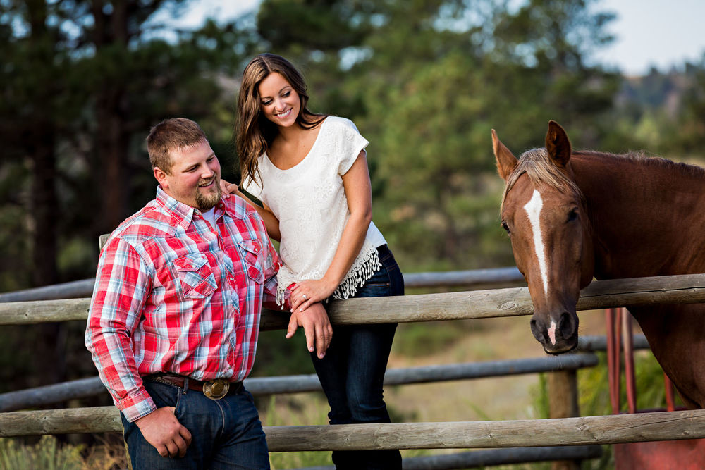 billings-montana-engagement-session-happy-couple-look-at-their-horse.jpg
