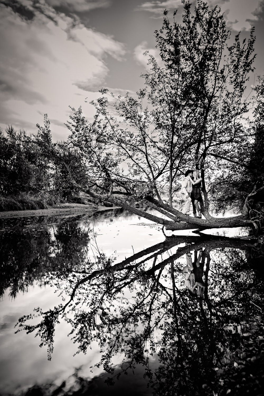 Billings-Montana-fall-engagement-couple-reflection-off-pond-black-and-white.jpg