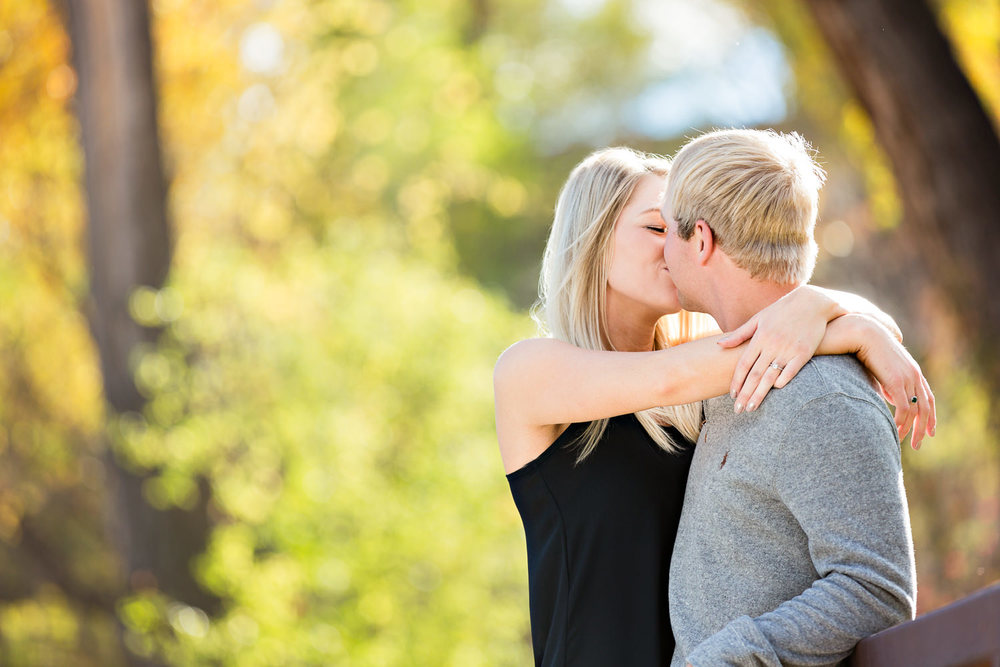 Billings-Montana-fall-engagement-kissing-in-colorful-park.jpg