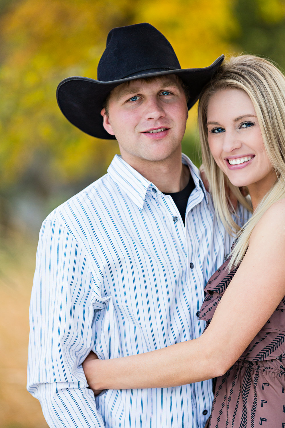 Billings-Montana-fall-engagement-man-with-cowboy-hat-and-his-lady.jpg