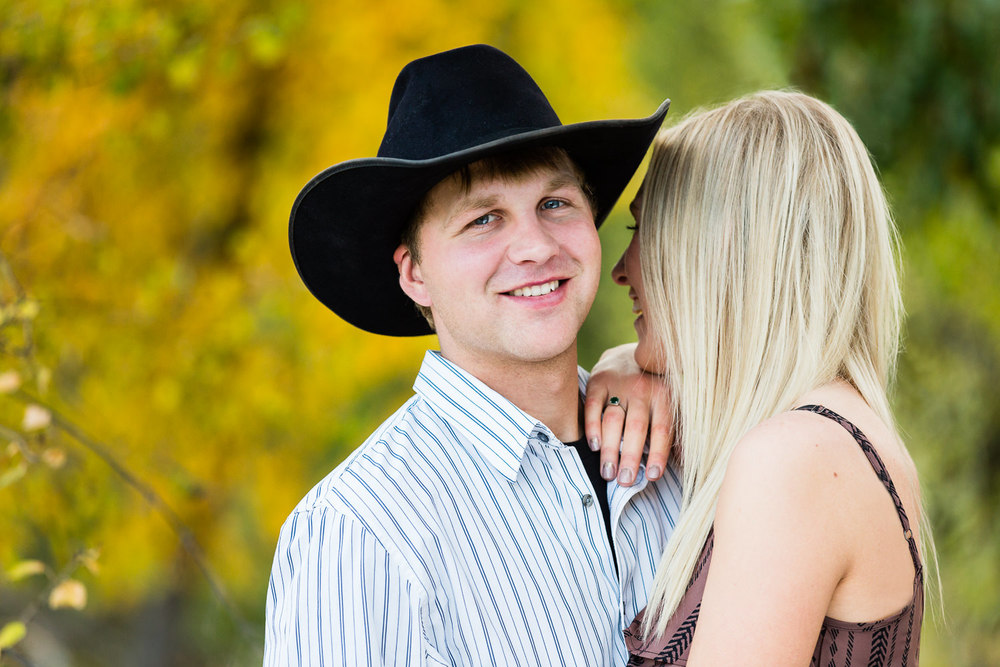 Billings-Montana-fall-engagement-photo-featuring-man-with-cowboy-hat.jpg