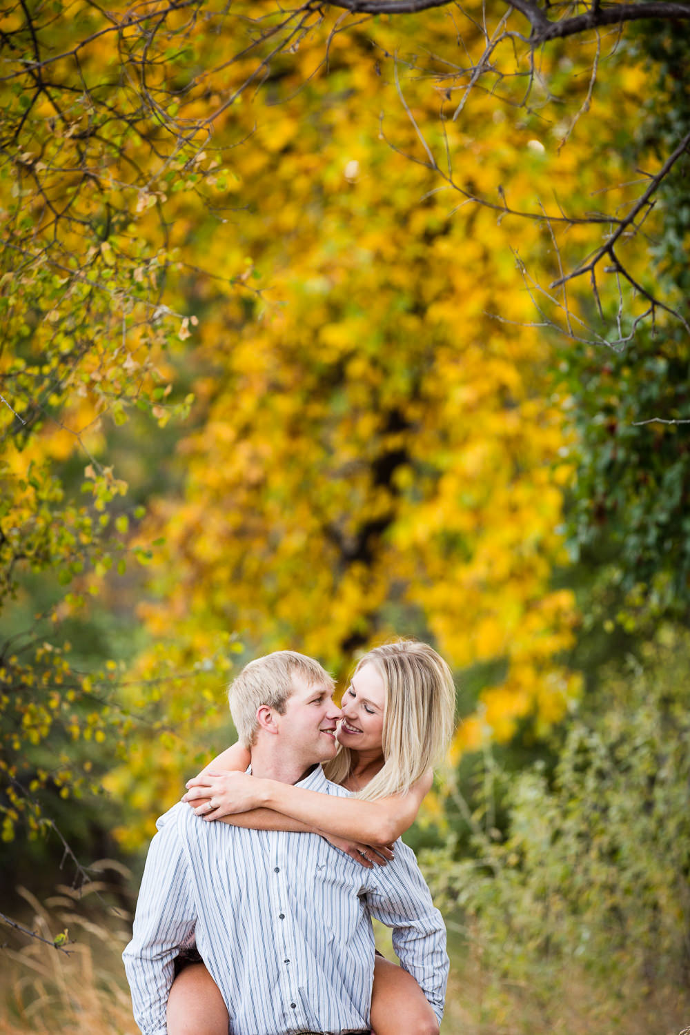 Billings-Montana-fall-engagement-playful-piggyback-ride.jpg