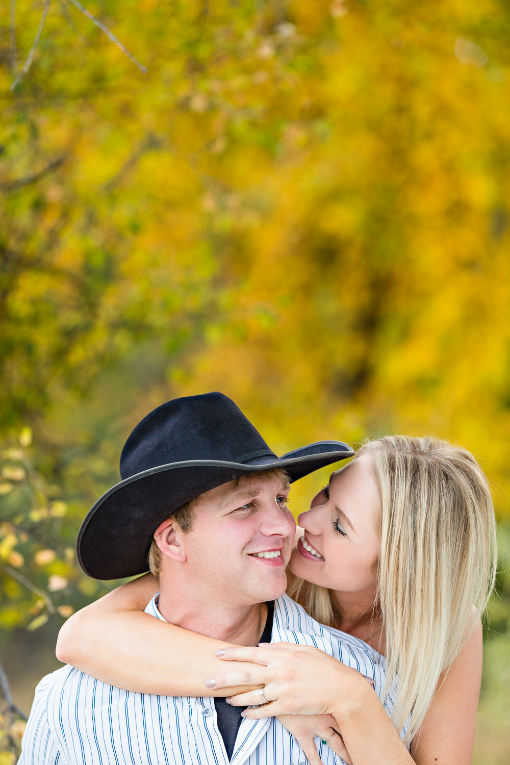 Billings-Montana-fall-engagement-woman-and-cowboy-laughing.jpg