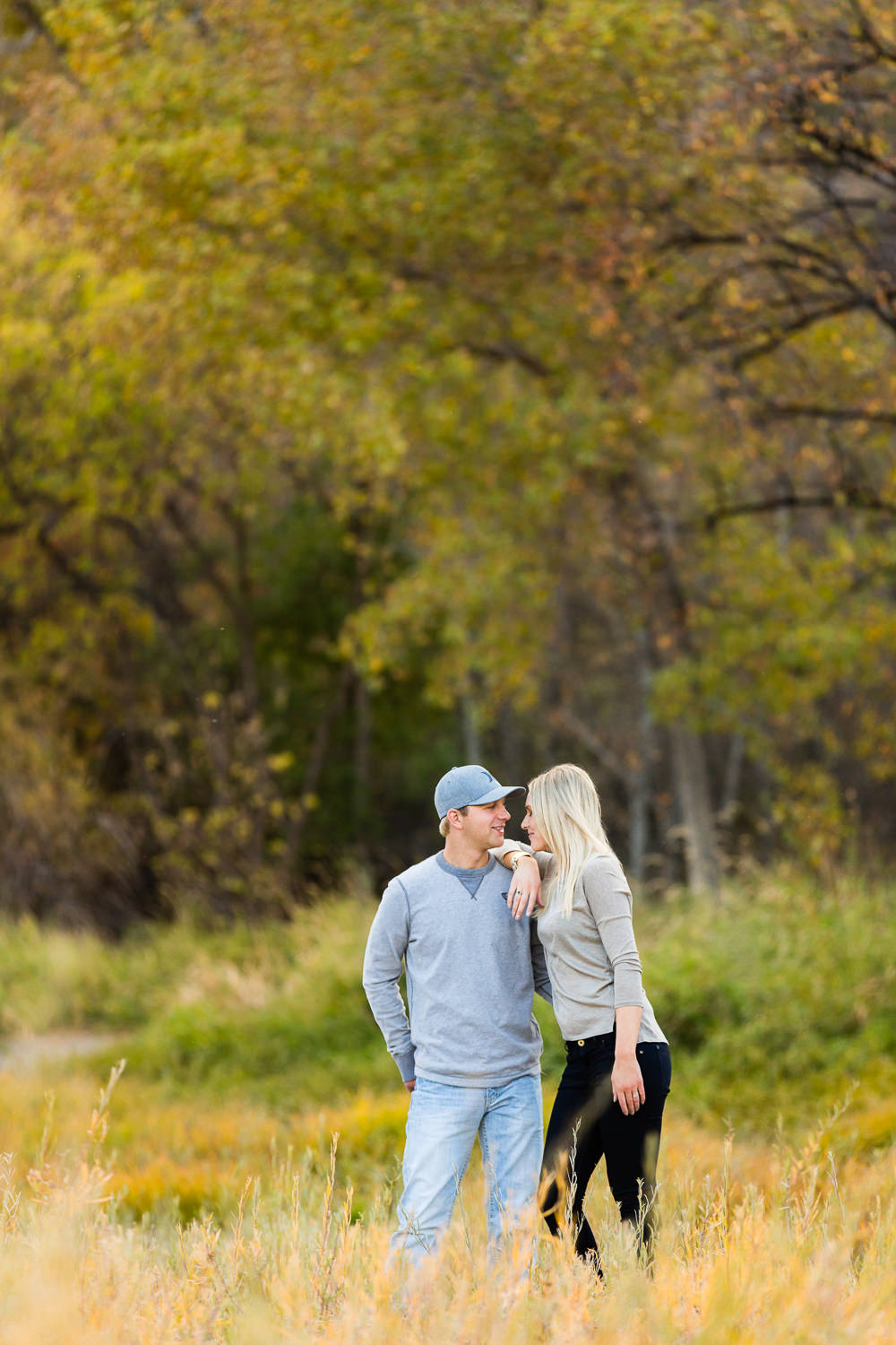 Billings-Montana-fall-engagement-woman-resting-on-mans-shoulder.jpg