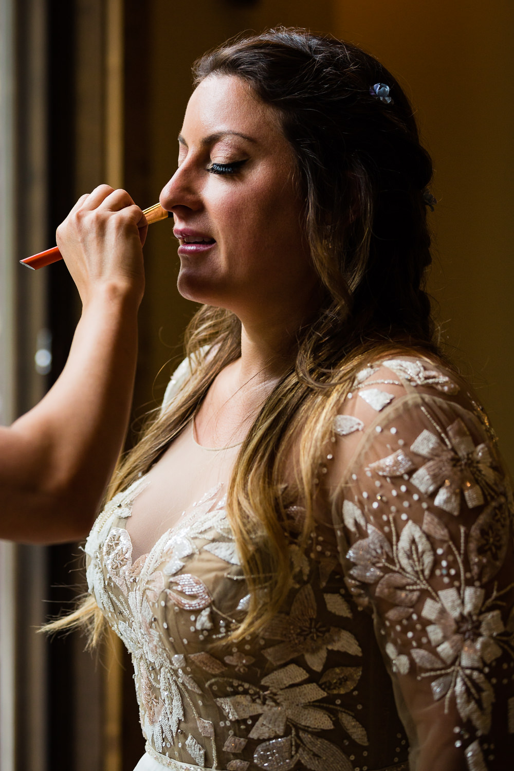 bozeman-hart-ranch-wedding-bride-does-final-makeup-check.jpg