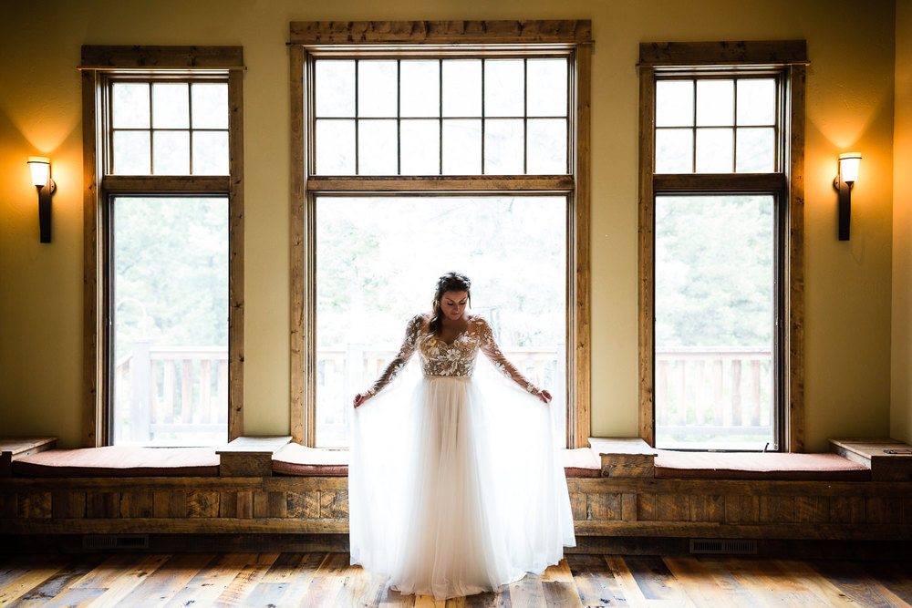 bozeman-hart-ranch-wedding-bride-plays-with-dress.jpg