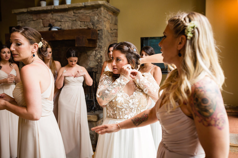 bozeman-hart-ranch-wedding-bride-puts-on-earrings.jpg