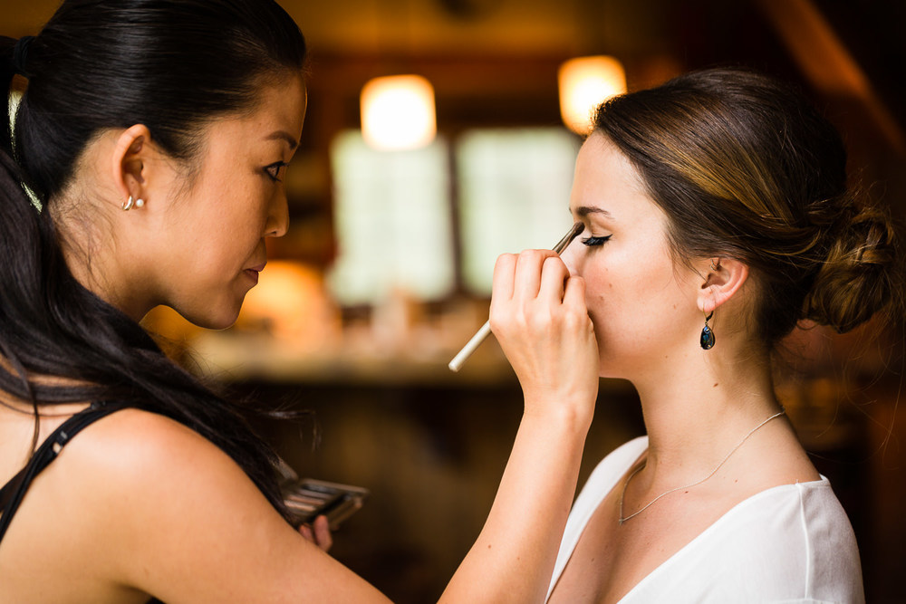 bozeman-hart-ranch-wedding-bridesmaid-gets-makeup.jpg