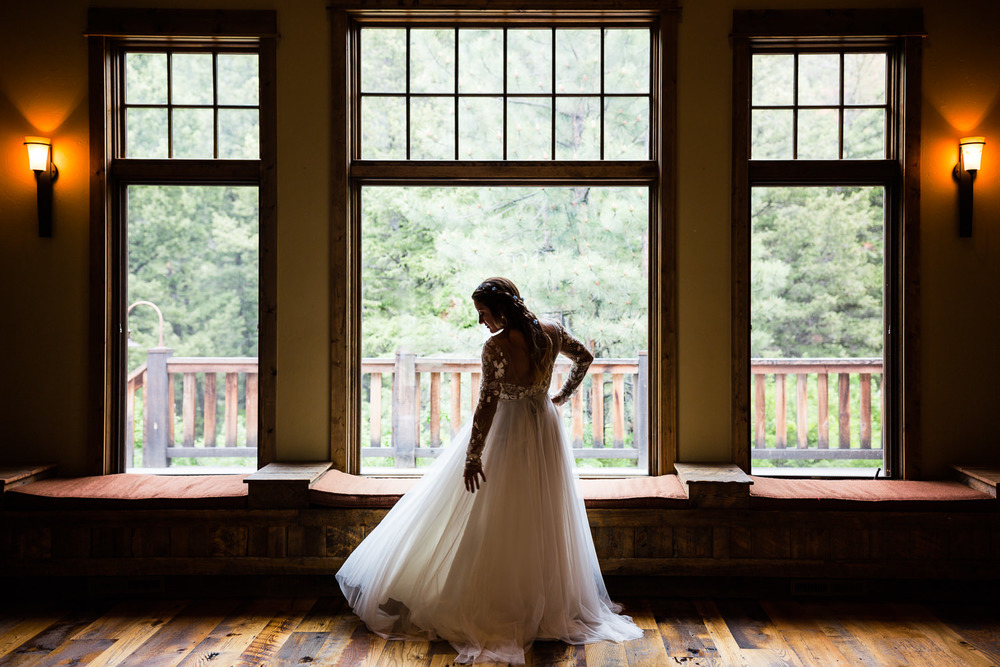 bozeman-hart-ranch-wedding-bride-twirls-dress.jpg