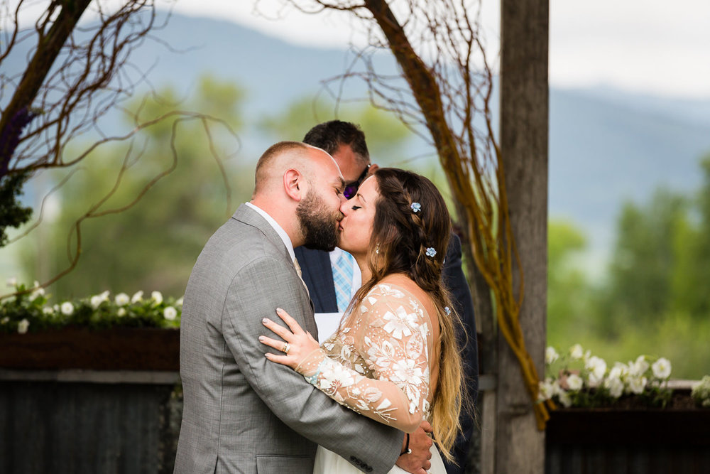 bozeman-hart-ranch-wedding-bride-groom-ceremony-kiss.jpg
