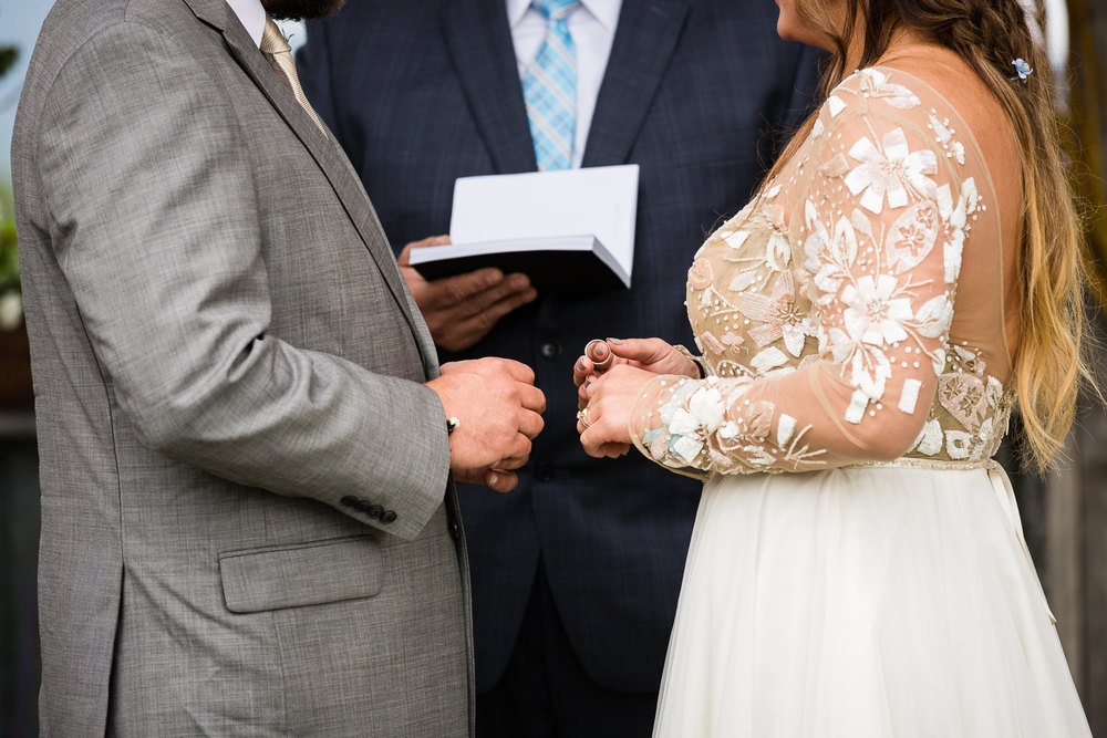 bozeman-hart-ranch-wedding-bride-groom-exchange-rings.jpg