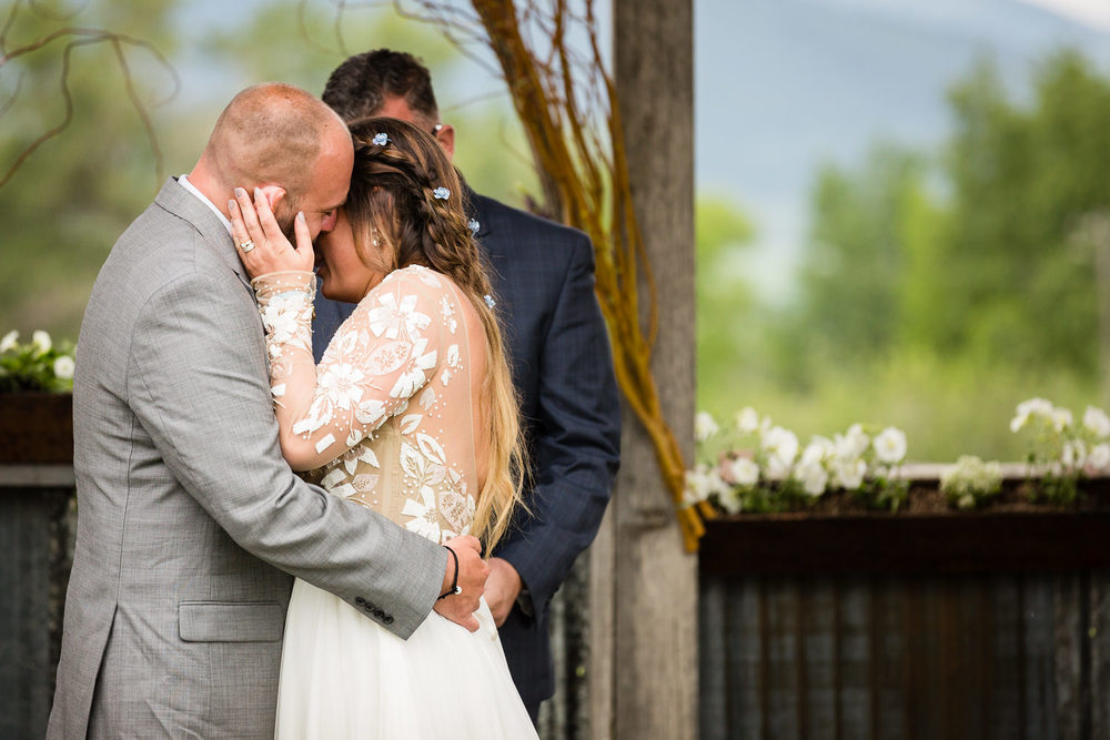 bozeman-hart-ranch-wedding-bride-groom-hug-during-ceremony.jpg