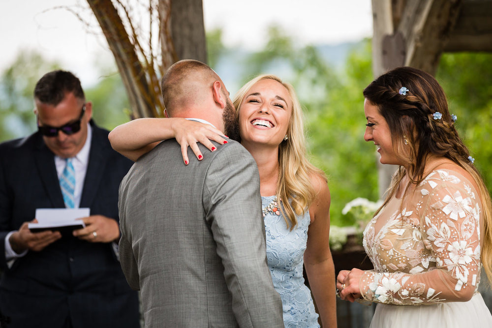 bozeman-hart-ranch-wedding-groom-hugs-friend-during-ceremony.jpg