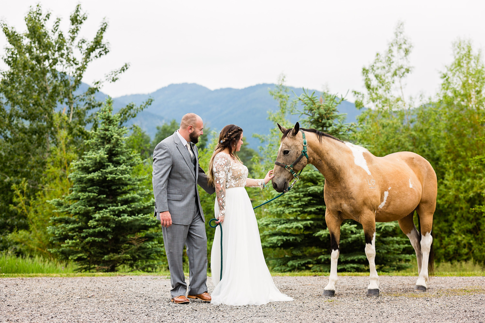 bozeman-hart-ranch-wedding-bride-groom-with-horse.jpg
