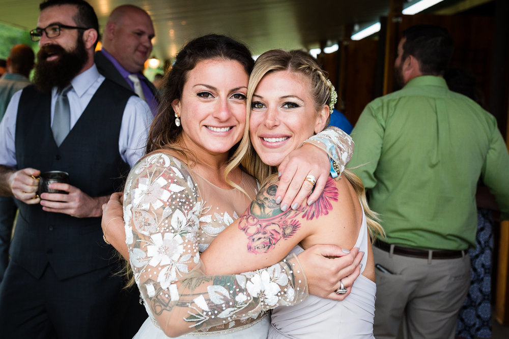 bozeman-hart-ranch-wedding-bride-and-best-friend-hug.jpg