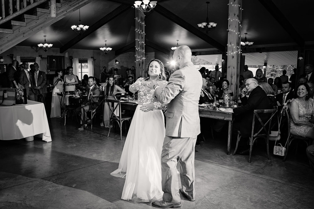 bozeman-hart-ranch-wedding-bride-groom-laugh-during-first-dance.jpg