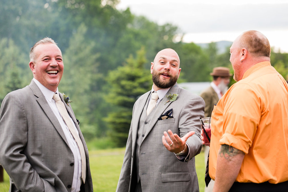 bozeman-hart-ranch-wedding-groom-laughing-with-friends.jpg