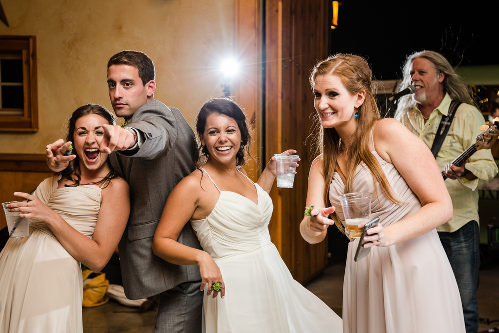 bozeman-hart-ranch-wedding-guests-laugh-at-reception.jpg