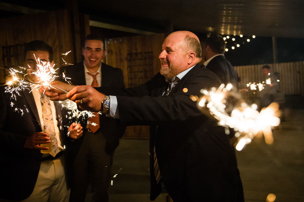 bozeman-hart-ranch-wedding-guests-light-sparklers.jpg