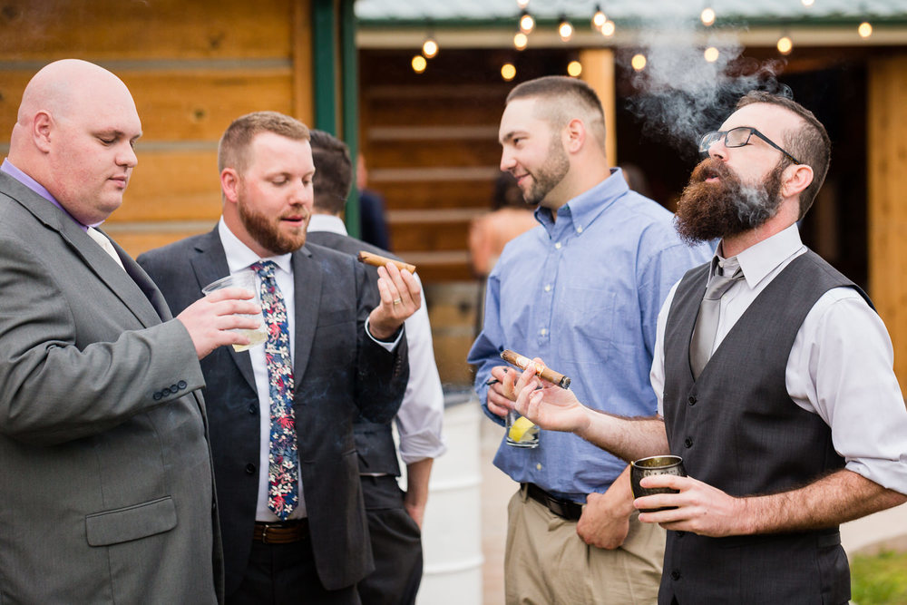 bozeman-hart-ranch-wedding-guests-smoke-cigar.jpg