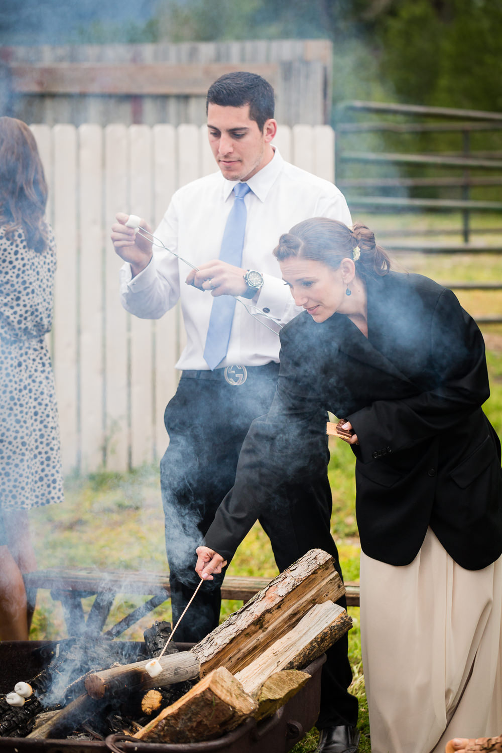 bozeman-hart-ranch-wedding-reception-guests-roasting-marshmallows.jpg