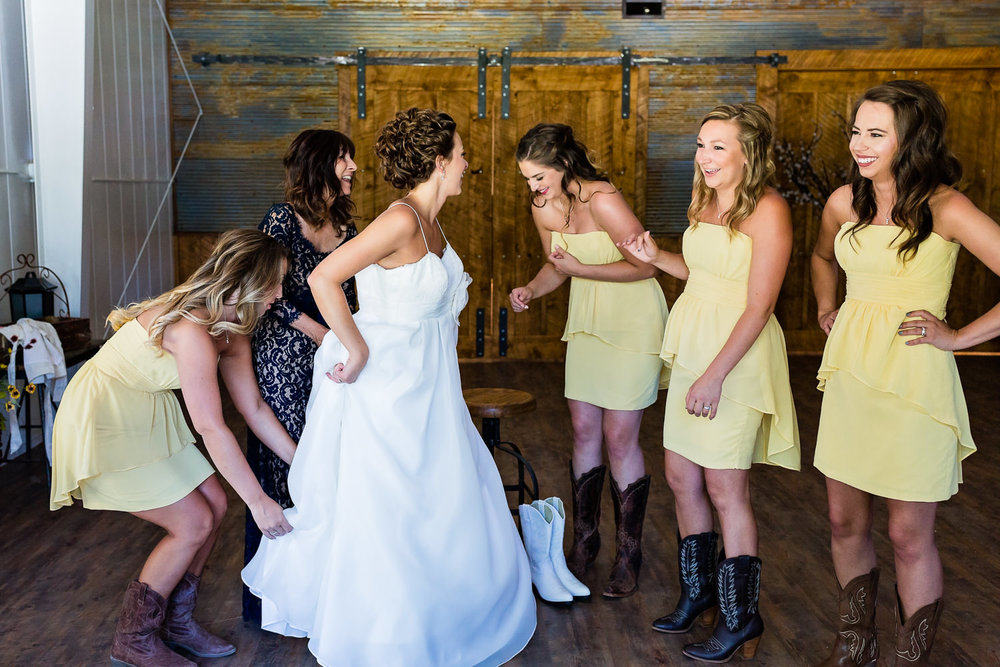billings-montana-swift-river-ranch-wedding-bride-puts-on-dress.jpg