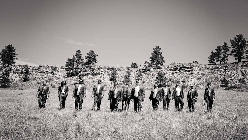 billings-montana-swift-river-ranch-wedding-groom-groomsmen-horse.jpg