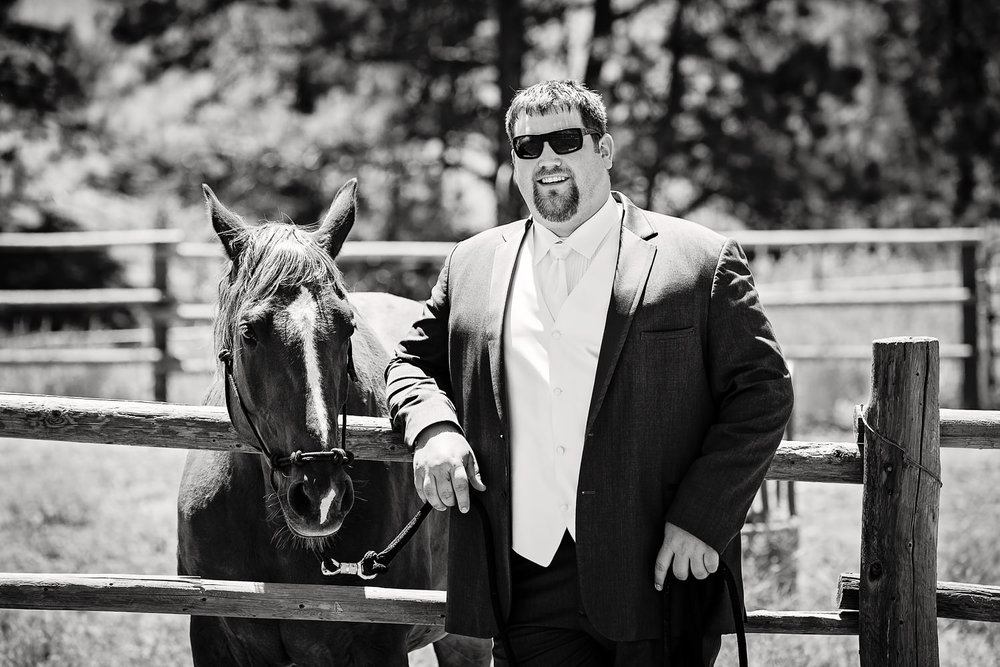 billings-montana-swift-river-ranch-wedding-groom-with-his-horse.jpg