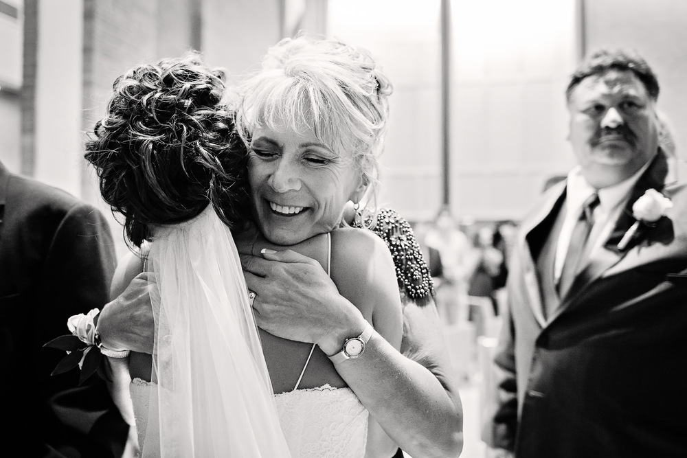 billings-montana-swift-st-thomas-mother-of-groom-hugging-bride.jpg